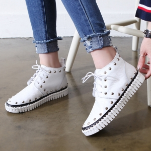 http://what-is-fashion.com/4760-37648-thickbox/women-s-real-leather-round-toe-corn-spike-studded-lace-up-high-topssneakers.jpg