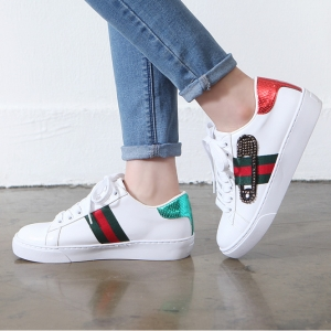 http://what-is-fashion.com/4865-38437-thickbox/women-s-safety-pin-embellished-lace-up-glitter-green-red-back-detailed-low-top-white-sneakers.jpg